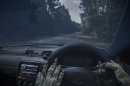 The hands of zombies and the steering wheel of a car.