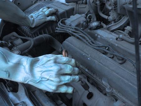 Auto mechanic zombie working in garage. Repair service .halloween .