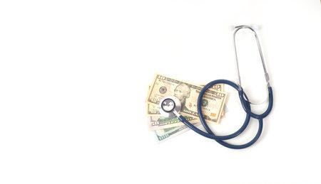 Stethoscope and dollars on white background. Archivio Fotografico