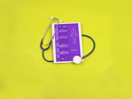 White tablet and stethoscope on a colored background. Online medical support concept.