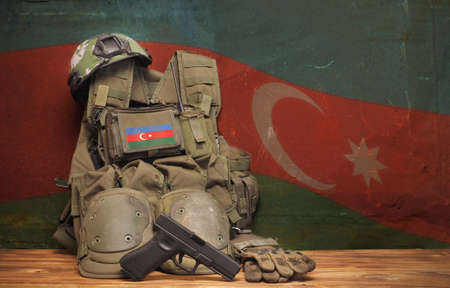 Azerbaijan National Holidays Concept. Flag and military uniform on rustic background. Mohammedan prayer