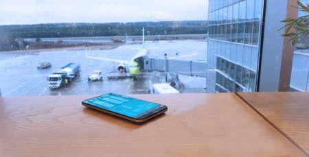 Digital immune passport at the airport. 版權商用圖片