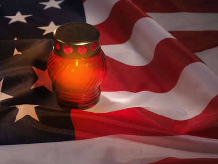 Candle-light ceremony on USA flag background. Moment of silence. 版權商用圖片