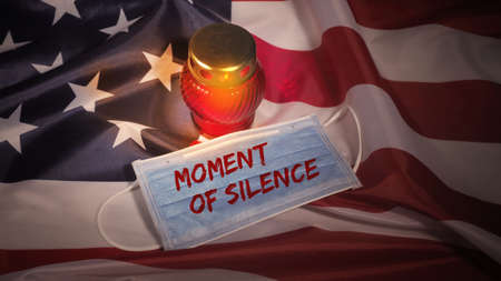 Candle-light ceremony and face mask on USA flag background.  victims.