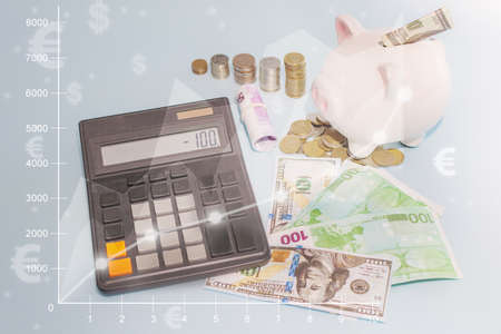 on a light background money, close-up - calculator, coins, piggy bank. idea - money account, accounting