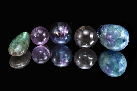labradorite: Labradorite, amethyst, rauchtopaz (smoky crystal) and fluorite on black background Stock Photo