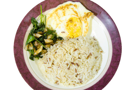 primrose oil: food for one meal, stir fried vegetable cooked rice fried egg. Stock Photo