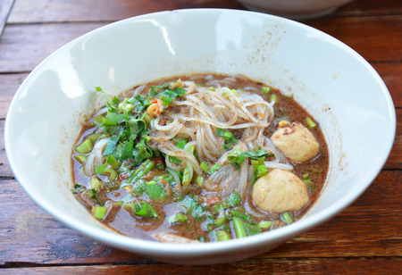 thicken soup fine cut white rice noodle in thailand