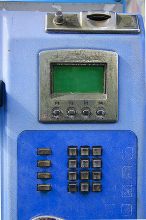 prominence: public telephone blue old