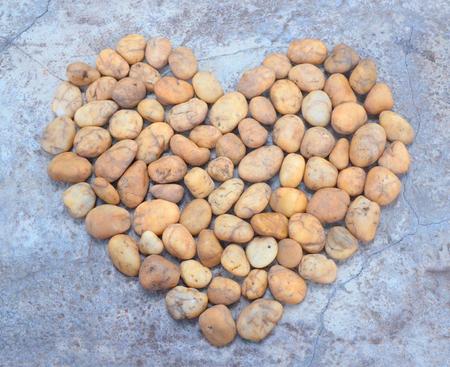 Orange stones arranged in a heart shape.