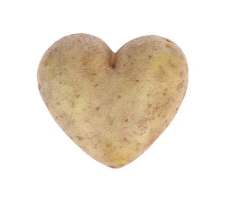 spud: Heart shaped potato spud, studio shot, isolated on white Stock Photo