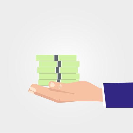 holds: Hand holds the money on a gray  background