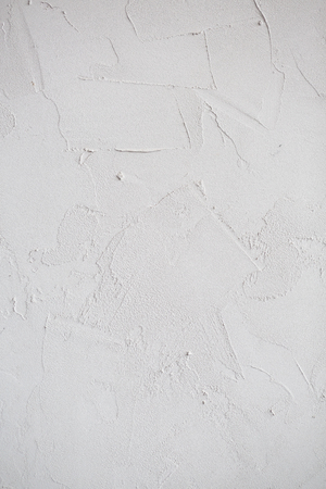 Plaster white wall. Grunge old peeled surface with shabby structure frame background. Whitewashed texture. Plastered shabby rustic wall background, copy space