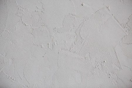 untidy: Plaster white wall. Grunge old peeled surface with shabby structure frame background. Whitewashed texture. Plastered shabby rustic wall background, copy space