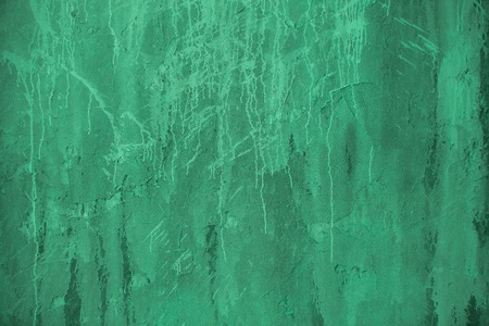 untidy: Plaster green wall. Grunge old peeled surface with shabby structure frame background. Whitewashed texture. Plastered shabby rustic wall background, copy space Stock Photo