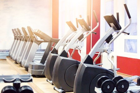 elliptical cross trainer in fitness room or class. Elliptic equipment in the gym with no people