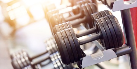 dumbbells in gym. Close up many dumbells in sport fitness centre
