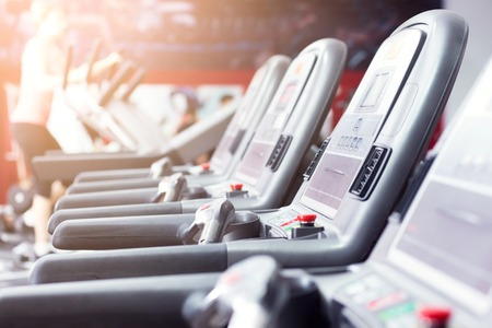elliptical cross trainer in fitness room or class. Elliptic equipment in the gym with no people close up Stock Photo