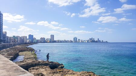 The Malecan Wall on the shores of Havana to the Blue Sea in Cuba