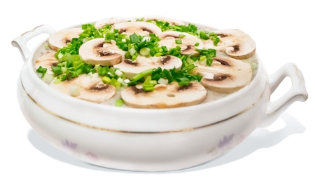Homemade Mushroom soup with onion isolated on white background