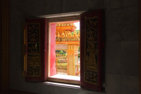 Open window in a old Buddhist temple, Asia, Thailand 写真素材