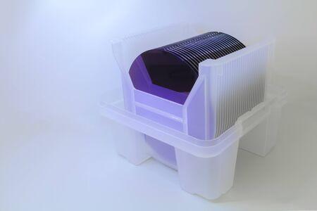 Empty silicon wafers purple color storage in plastic box, prepared for microchip production