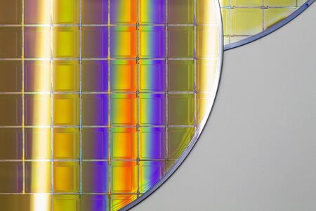 Silicon Wafers with microchips - A wafer is a thin slice of semiconductor material, such as a crystalline silicon pieces of wafers with microchips.Rainbow on silicon wafers.Color silicon wafers with glare.