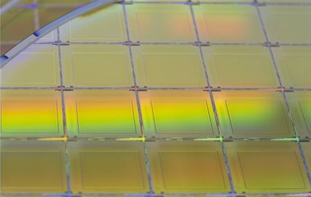 Silicon Wafers with microchips - A wafer is a thin slice of semiconductor material, such as a crystalline silicon, used in electronics for the fabrication of integrated circuits.Several pieces of wafers with microchips.