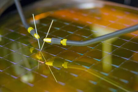 Checking microchips on silicon wafer with probe station.Close up . Semiconductor Crystal Manufacturing.