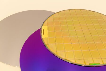 Silicon Wafers three types -empty grey wafer,purple wafer with SiO film and gold wafes with microchips.Several pieces of wafers with microchips.Rainbow on silicon wafers.Color silicon wafers with glare.