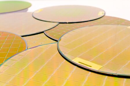 Many Silicon Wafers three types - gold color wafes with microchips.Several pieces of wafers with microchips.Rainbow on silicon wafers.Color silicon wafers with glare.