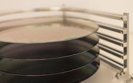 Silicon Wafers - A wafer is a thin slice of semiconductor material, such as a crystalline silicon, used in electronics for the fabrication of integrated circuits.