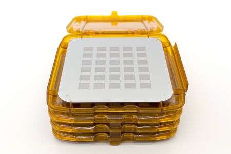 Photo of photomask for photolithography process. In orange boxes ready for process manufacturing semiconductors Reklamní fotografie