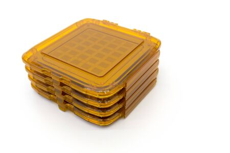 Photo of photomask for photolithography process. In orange boxes ready for process manufacturing semiconductors