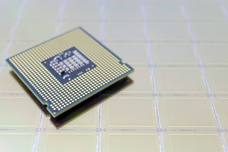 Photo of a Computer Chip CPU put on silicon wafer with microchip gold color Reklamní fotografie