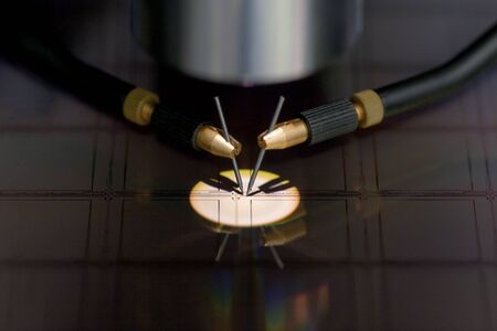 Checking microchips on silicon wafer with probe station.Close up . Semiconductor Crystal Manufacturing.Selective focus. Banco de Imagens - 146283953
