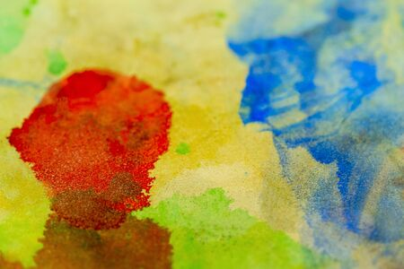 Abstract watercolor background of stains of colored paint.