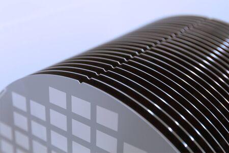 Empty silicon wafers grey color storage in plastic box, prepared for microchip production