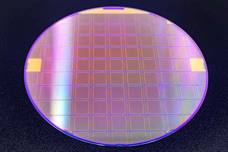 Silicon wafer with microchips on black background. Reklamní fotografie