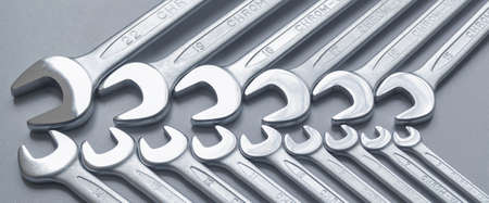 Cut-out wrenches horizontally placed from the biggest to the smallest in a row. Top view composition. Hand tool.Banner.