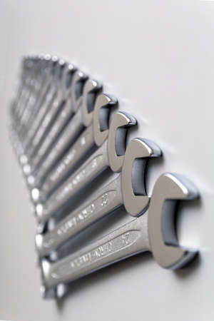 Cut-out wrenches horizontally placed from the biggest to the smallest in a row. Top view composition. Hand tool. Tools for carpentry work.