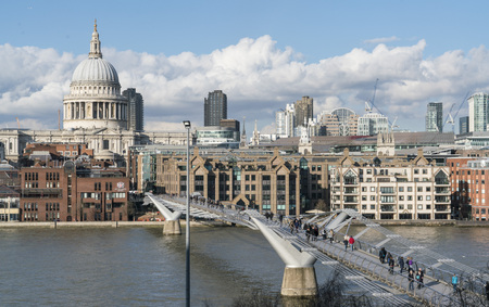millennium bridge: St. Pauls cathedral London and Millennium Bridge over River Thames LONDON, ENGLAND - FEBRUARY 22, 2016 Editorial