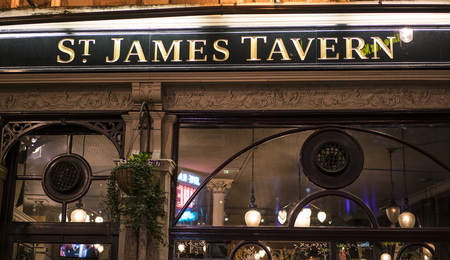 guinness beer: Traditional English Pub St. James Tavern LONDON, ENGLAND - FEBRUARY 22, 2016 Editorial