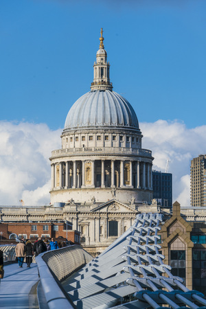 millennium bridge: St. Pauls cathedral London and Millennium Bridge over River Thames LONDON, ENGLAND - FEBRUARY 22, 2016 Editorial
