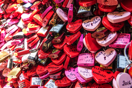 love proof: Locks attachted to the wall of Juliets house in Verona as a proof of love