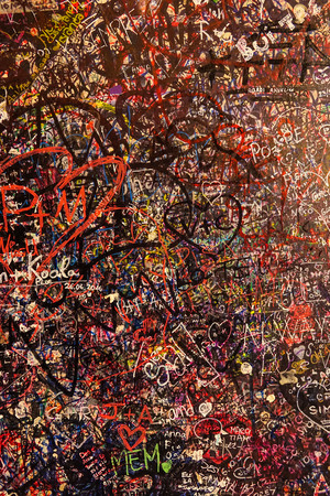 love proof: Awesome wall totally covered with love proof graffiti at Juliets house in Verona