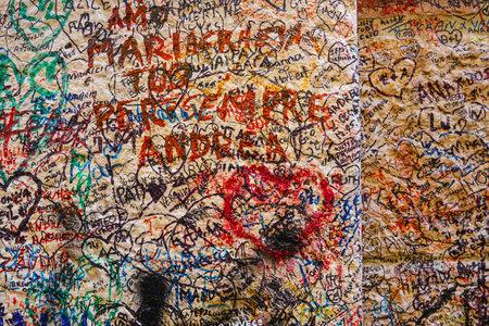 juliet: World famous Love graffiti and writings on the wall at Juliet house in Verona - Casa di Giulietta