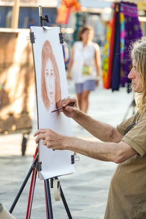 st mark's square: Street painter at St Marks Square in Venice