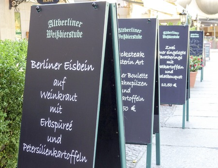 comida alemana: The menu of a typical German food restaurant in Berlin - BERLIN  GERMANY - AUGUST 31, 2016 Editorial