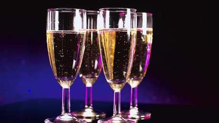 Colorful Glasses of Champagne - beautifully illuminated Stock Photo